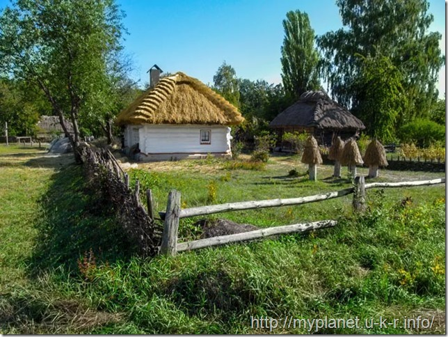 Ukrainian ancient traditional rural landscape with a hut with white walls and thatched roof
