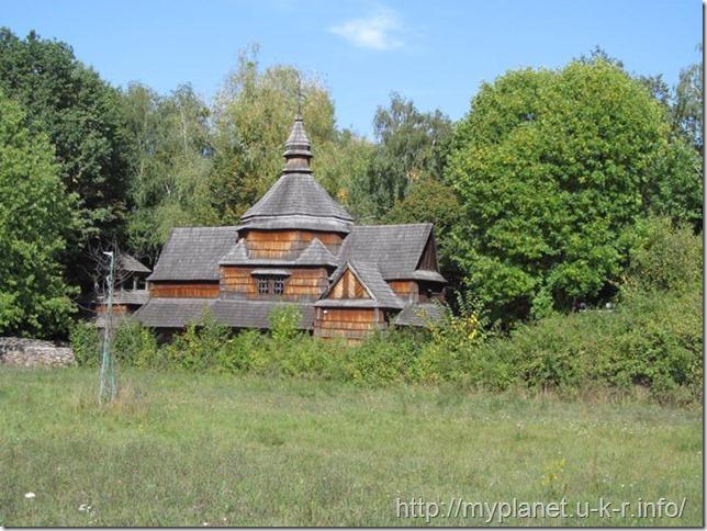 """Old wooden church in """"Podolia Region"""" in Pirogov"""